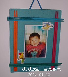 用布和筷子做的相框.